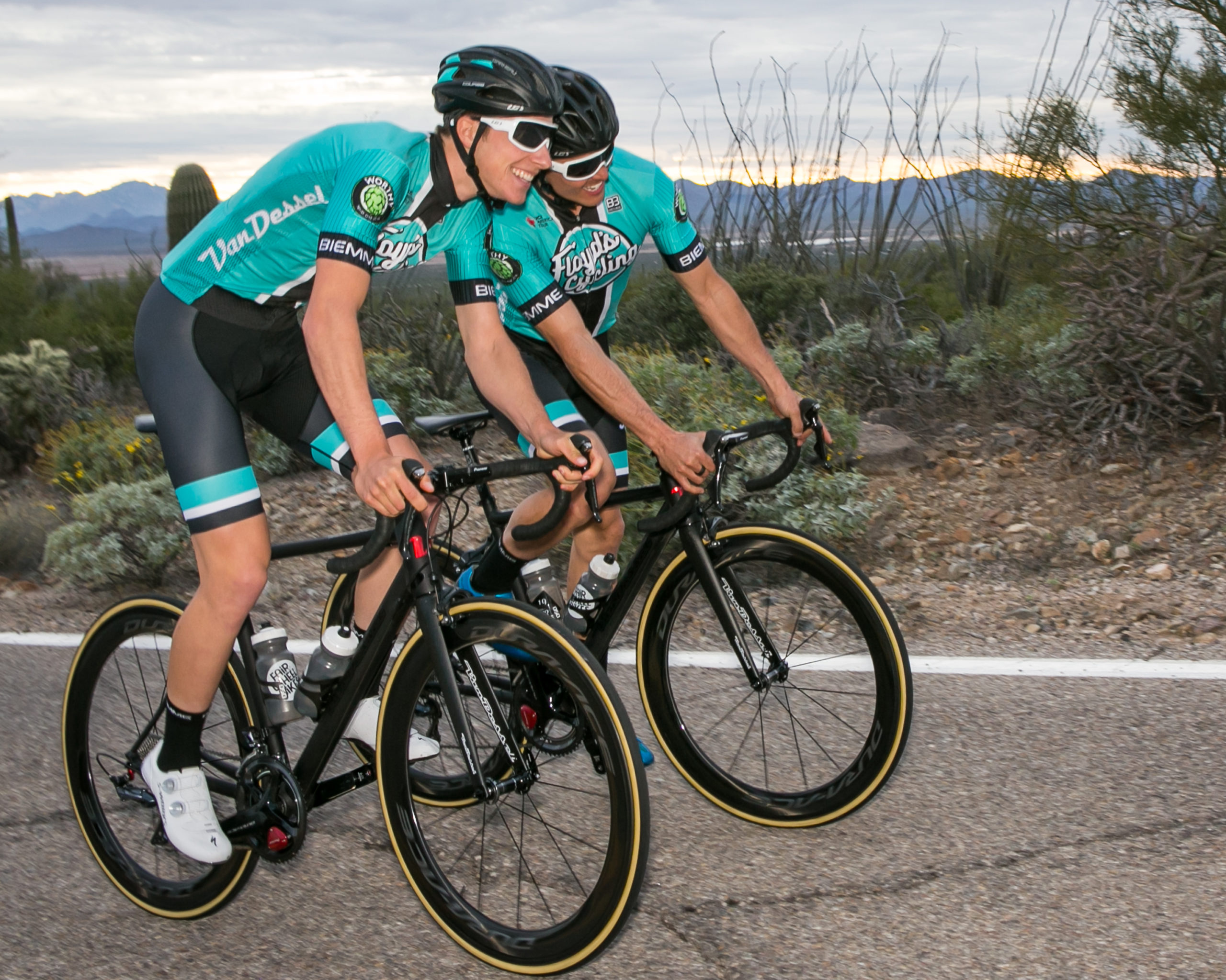 Nickolas Zukoswky and Travis McCabe bump shoulders in play at the end of the long day of promotional photography for Floyd's Pro Cycling Team.