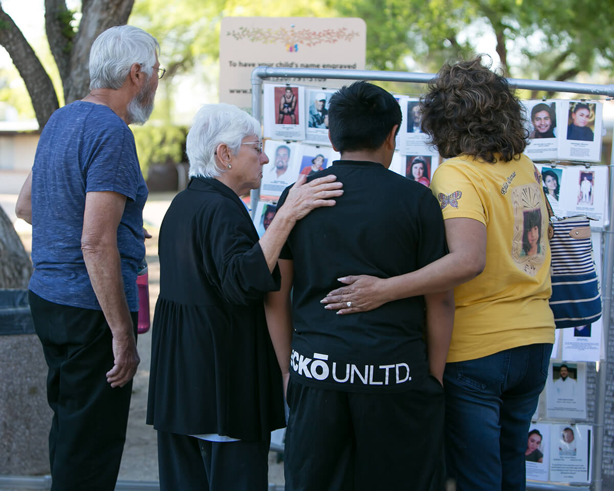 Homicide Survivors Inc provides no cost supportive services for families who have lost a loved one to murder. This image is taken from a candlelight vigil.