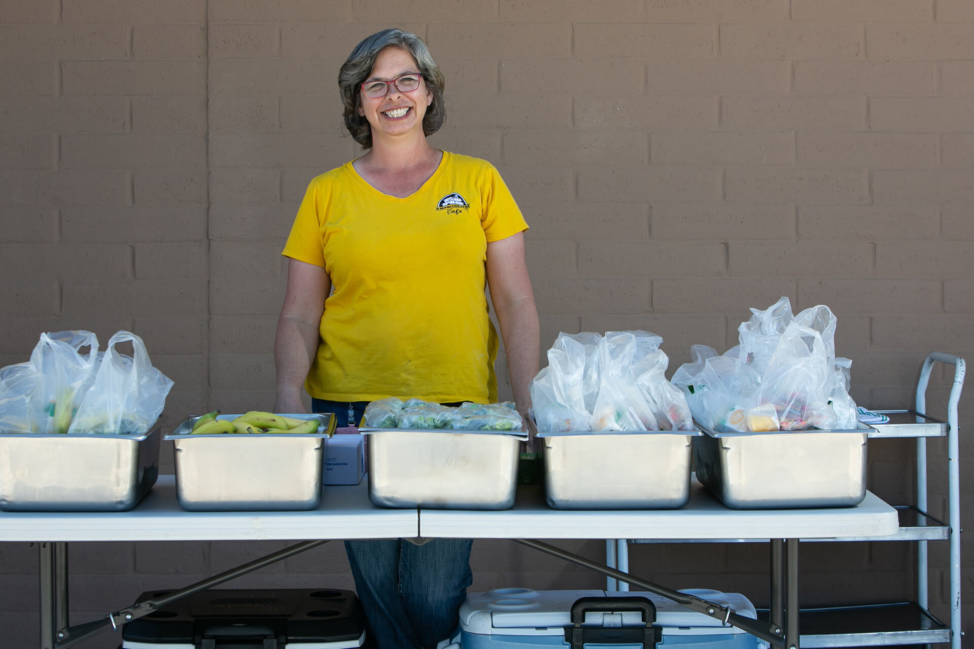 """""""To hear this is helping families gives us a purpose. Parents mention it's hard to feed a typical lunch or breakfast to her family because of the limits on items in the stores. Many tell us it's the highlight of their kids day. The breakfast and lunches served throughout our district is close to 29,500 weekly."""" – Colleen, Lunch Lady"""