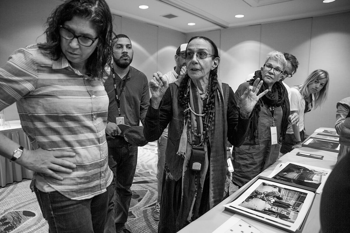 Mary Ellen Mark critiquing the work of students in what was to become her last teaching seminar, one month before she passed in 2015. One may never know the importance of documenting a fleeting moment until the person is gone.