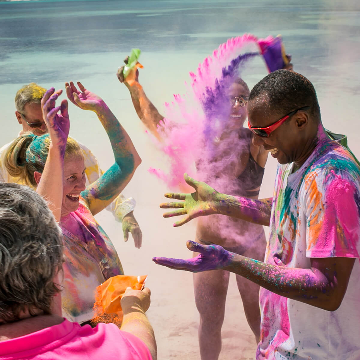 Troy and Mary's friends surprise them with a paint powder celebration during their wedding rehearsal.