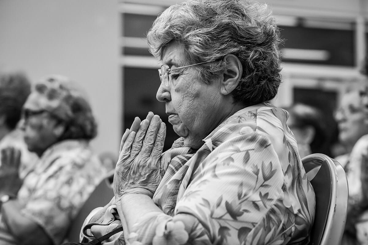 An elder learns a meditation technique during Evoke/KYNE Take Care Festival.