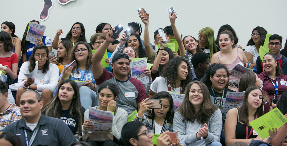 High school students joyfully participate in a group presentation during the Annual Youth and Peace Conference which promotes Kingian non-violence philosophy.