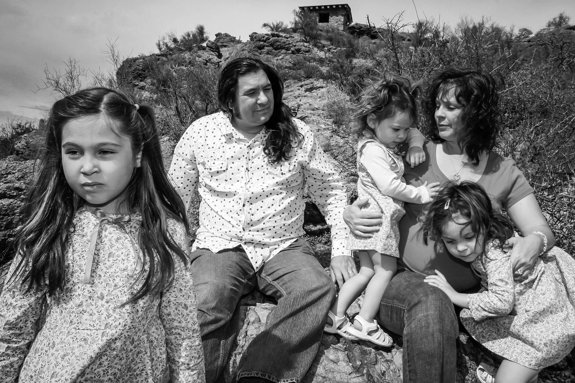Some of the best family portraits are completely unplanned and uncomposed. The three little daughters were not interested in posing, sitting still or smiling, not one bit.