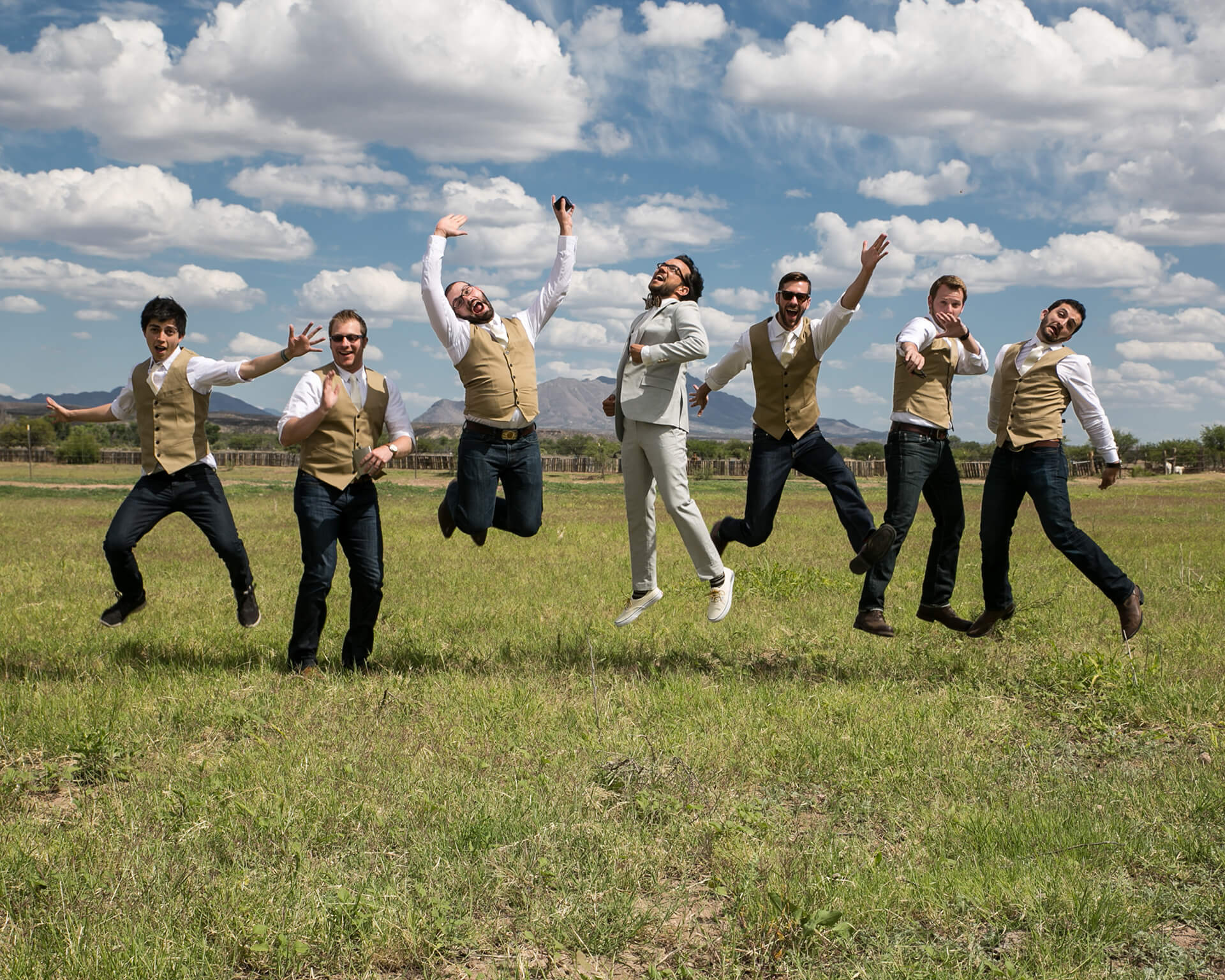 Sensing the dynamics of the group she is photographing as well as incorporating the uniqueness of the available environment, Kathleen playfully creates spontaneous portraits such as this party of groomsmen.