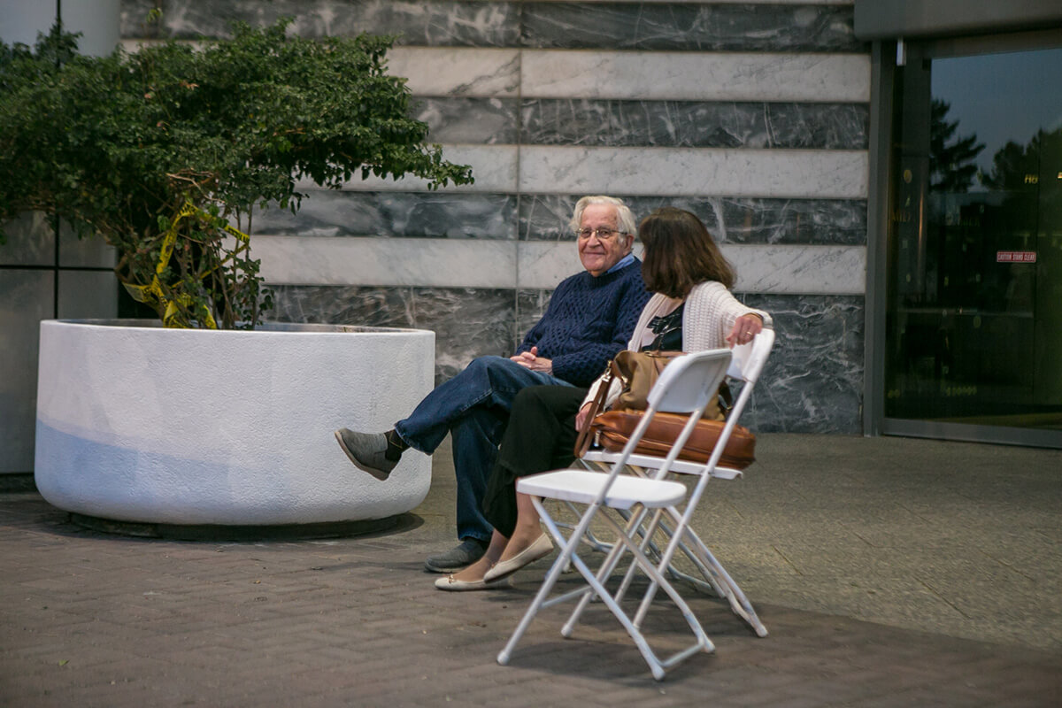 Linguist, philosopher, cognitive scientist, historian, social critic, and political activist, Noam Chomsky, relaxes with his wife before a presentation on the grounds of the main public library in Tucson. Spontaneous moments are often the most poignant and powerful.