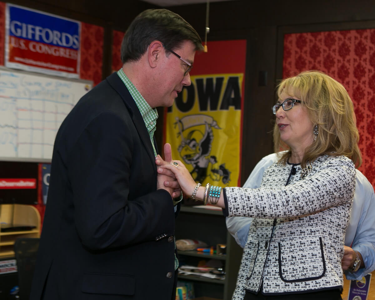 In a private room after a public speech, Democratic gubernatorial candidate Steve Farly and Senator Gabby Giffords greet each other. It is a privilege for Kathleen to have access to these historic moments between dignitaries and leaders.
