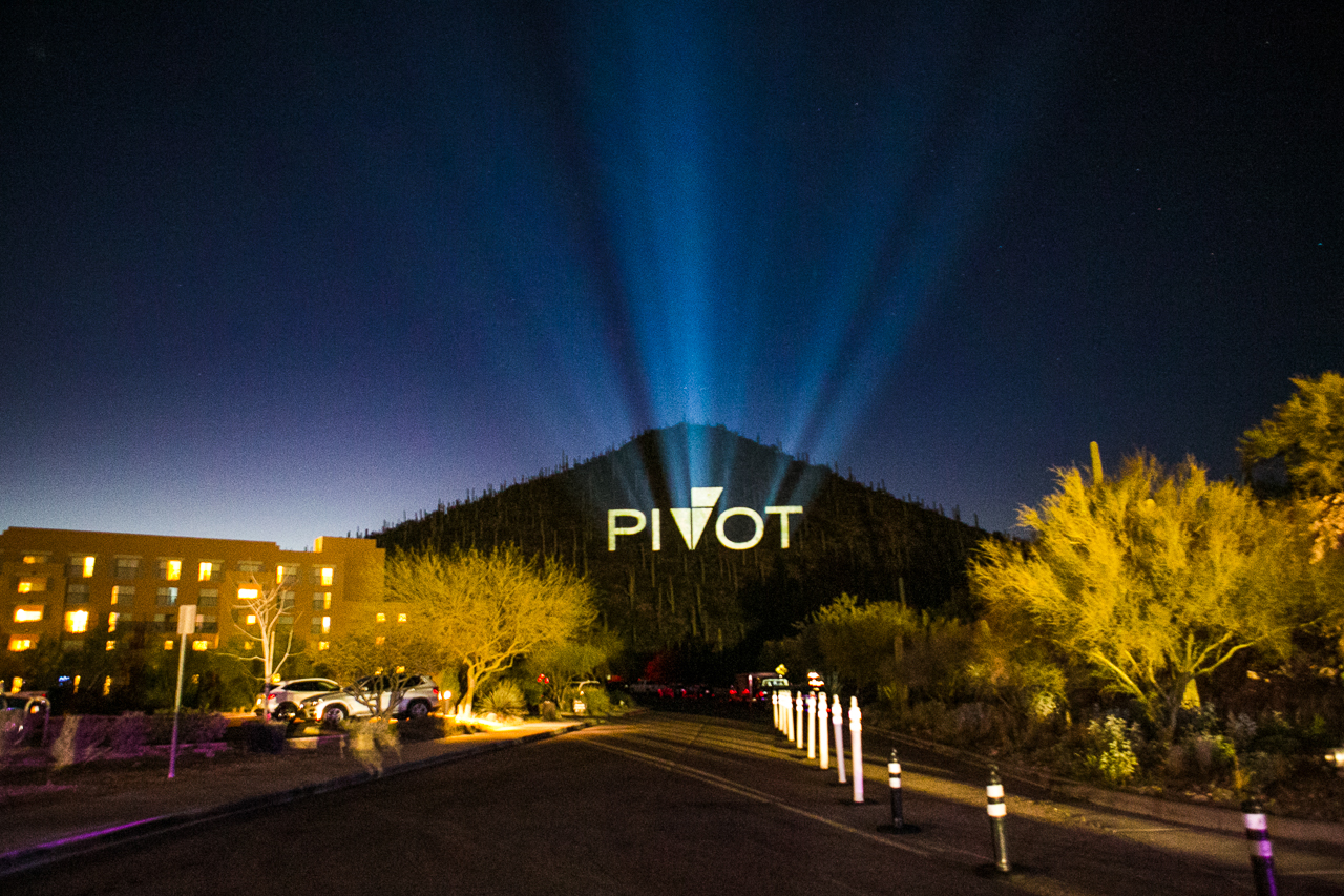 Environmental details of a corporate event, the company's logo is illuminated on a nearby Tucson mountain creating a beautiful effect.