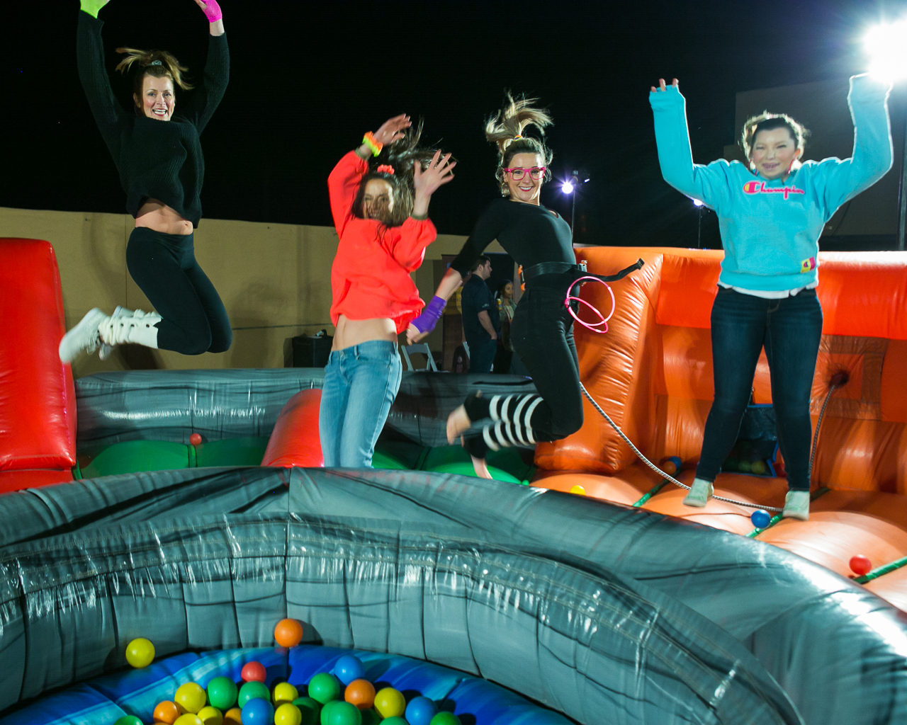 Kathleen climbed into the jumping pit with event attendees to capture this image. As a corporate event photographer, Kathleen goes to great lengths to document the full story of the event.