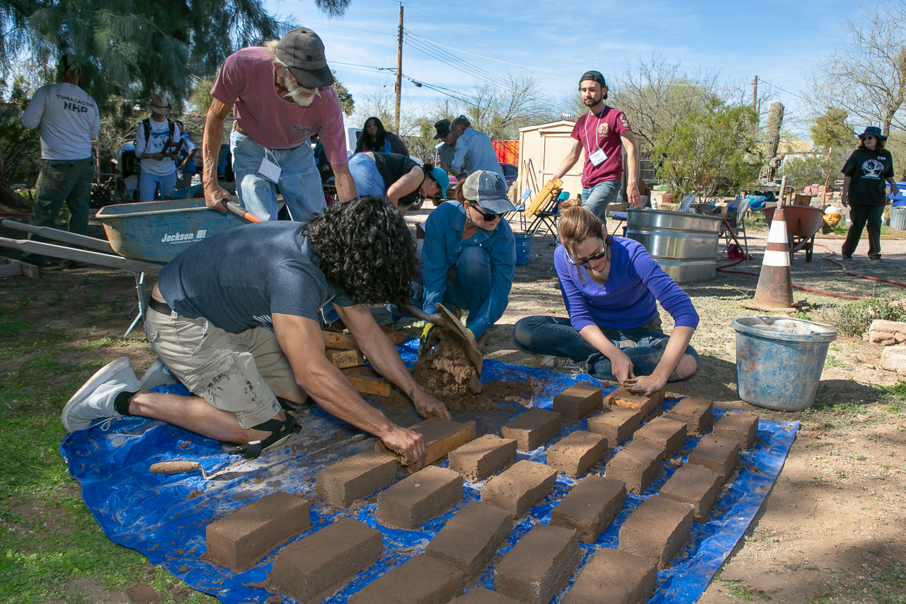 Spnsored by a local education program, adults learn the ancient art of adobe brick-making during a community education hand-on class.