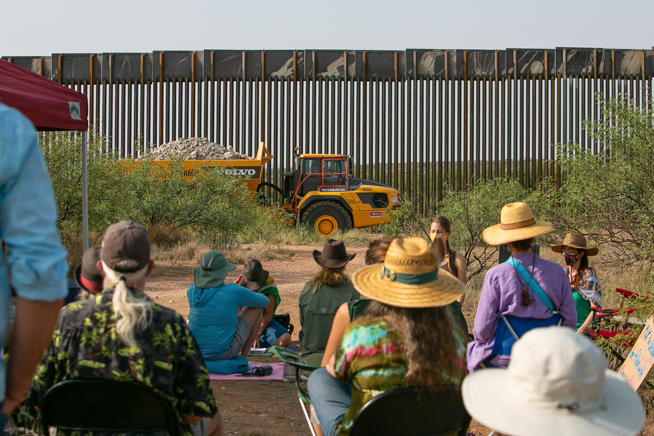 In a peaceful protest, Buddhists meditate at the border wall being built near Sasabe, Arizona.