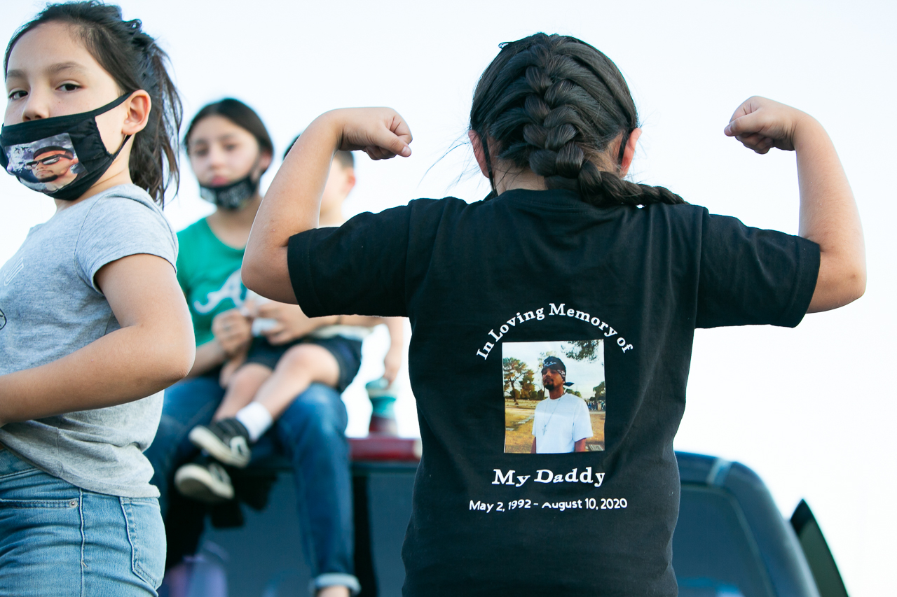 A child honors her father during Homicide Survivors Inc's National Day of Remembrance.